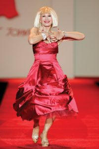 Betsey Johnson on the runway with a red dress