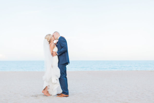 Newly Weds First Kiss at the Beach | 59&Bluebell Weddings and Events