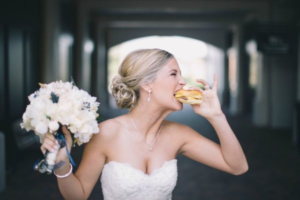 Newly Wed Wife Biting into a Hamburger |59&Bluebell Weddings and Event