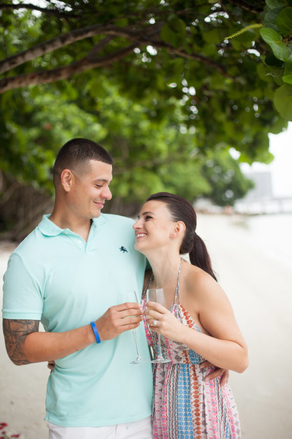 Fiancé and fiancée Make a Toast at the Beach | 59&Bluebell Weddings and Events
