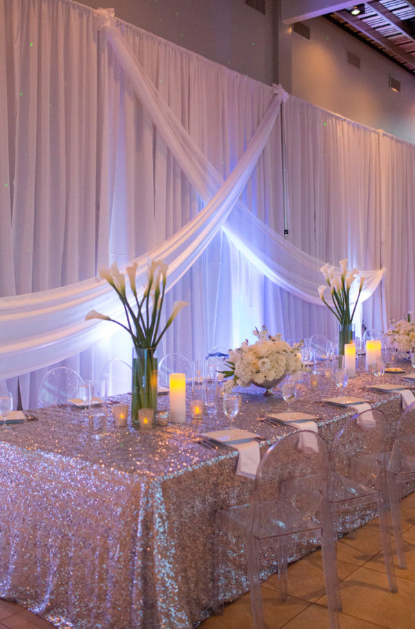 Decorated Head Table with Lights, Flowers, Candles and Seats | 59&Bluebell Weddings and Events
