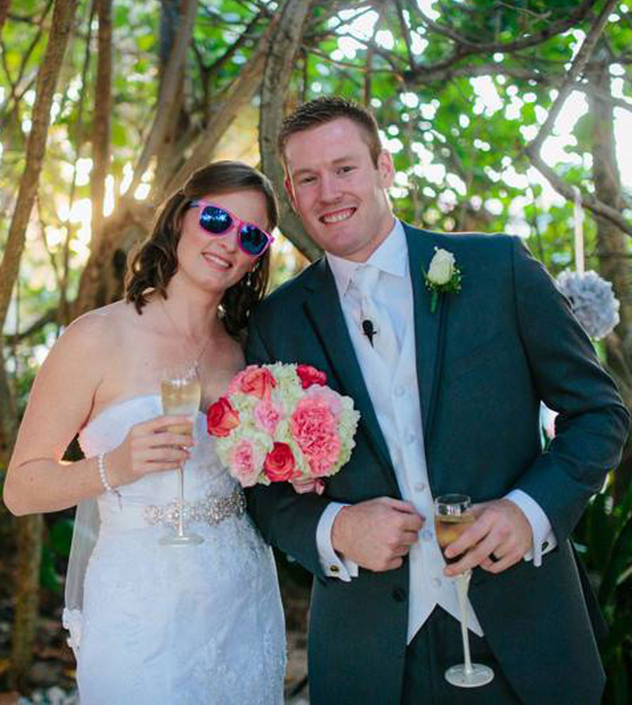 Husband and Wife smiling while holding a glass of champagne | 59&Bluebell Weddings and Event